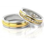Obrączki ślubne z białego złota ozdobione białymi kamieniami