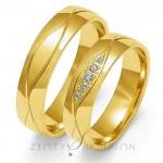 Eleganckie i subtelnie ozdobione złote obrączki ślubne