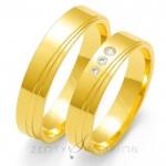 Subtelne złote obrączki ślubne z intrygującym nacięciem