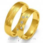 Wyjątkowe złote obrączki ślubne czarująco ozdobione