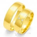 Jednobarwne złote obrączki ślubne z oryginalnie osadzonymi kamieniami