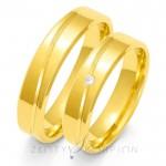 Obrączki ślubne z ukośnym nacięciem i diamentem
