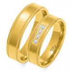 Eleganckie złote obrączki ślubne z finezyjnym zdobieniem