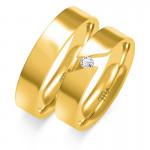 Obrączki ślubne z białego złota z oryginalnie osadzonym kamieniem