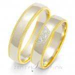 Urocze obrączki ślubne z żółtym zdobieniem obsadzone kamieniami