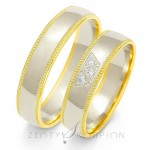 Urocze obrączki ślubne z żółtym zdobieniem obsadzone diamentami