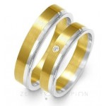 Obrączki złote o nowoczesnym kształcie z brylantem