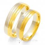 Obrączki złote z symetrycznymi nacięciami ozdobione brylantem