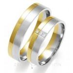 Złote obrączki ślubne z trzema diamentami