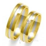 Eleganckie dwubarwne obrączki ślubne z jedną cyrkonią