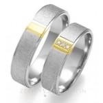 Obrączki ślubne z białego i zółtego złota z brylantami