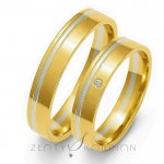Obrączki ślubne z żółto-białego złota z subtelnie lśniącym brylantem