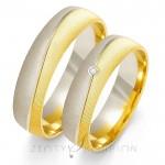 Złote obrączki ślubne ozdobione brylantem