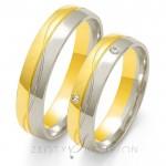 Obrączki ślubne półokrągłe z białego i żółtego złota z brylantem