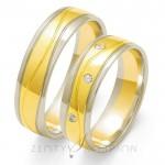 Złote obrączki ślubne żółte z białymi brzegami ozdobione brylantami