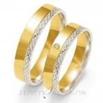 Złote obrączki ślubne z cyrkonią i diamentowaną krawędzią
