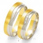 Obrączki ślubne z białego i żółtego złota z wyrafinowanym zdobieniem