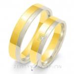 Złote obrączki ślubne z lśniącym diamentem