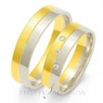 Złote obrączki ślubne z ukośnie osadzonymi kamieniami