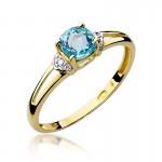 Gustowny pierścionek zaręczynowy z białego złota ozdobiony topazem i diamentami