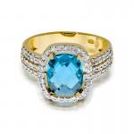 Nietuzinkowy złoty pierścionek bogato wysadzany topazem i diamentami